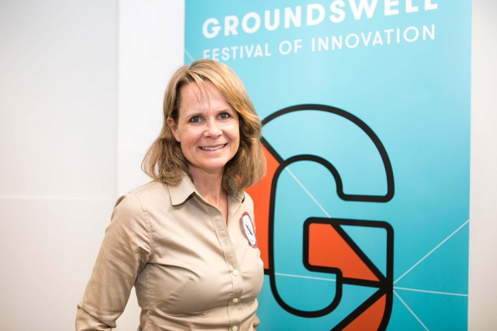 Kirstin joiner in front of Groundswell Festival banner